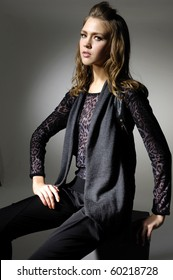 fashion model in modern dress sitting in the studio