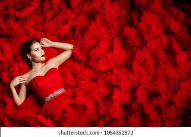 Fashion Model on Red Dress Background, Woman Beauty Portrait, Beautiful Girl Posing over Waves Fabric