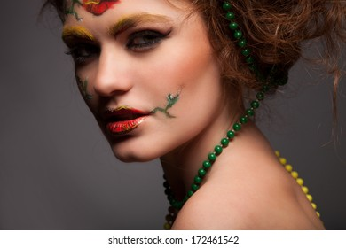 Fashion Model Portrait with art make up flowers face.