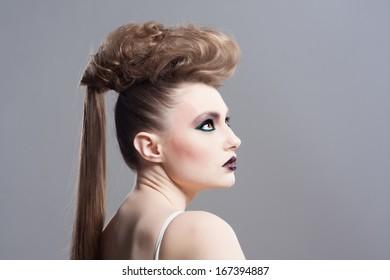 Fashion Model Portrait. Hairstyle. Haircut. Professional Makeup. Creative makeup. Closeup portrait. Studio shot.