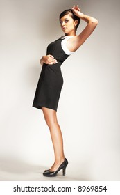 Fashion model Posed on light background in dark dress