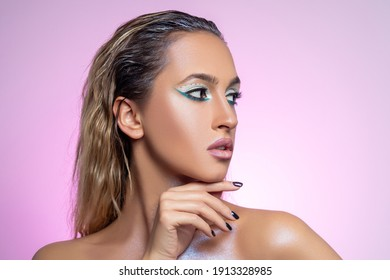 Fashion model posing on bright background. Beautiful young woman portrait.