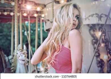 Fashion model posing on carousel