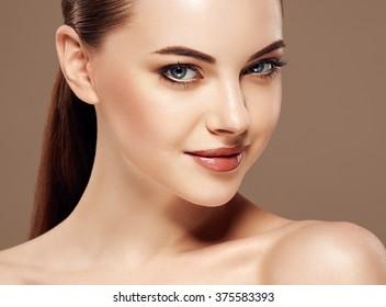 Fashion model posing at studio close-up face beautiful