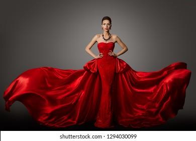 Modemodellrotes Kleid, Frau in Long Fluttering Waving Gown, Porträt der jungen Girl Beauty