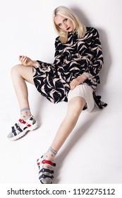 fashion model sitting on a floor