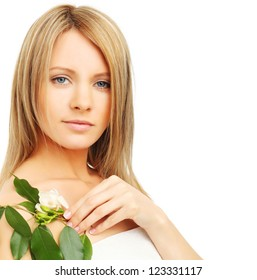 Fashion model with spring green leaves and flowers, spa theme