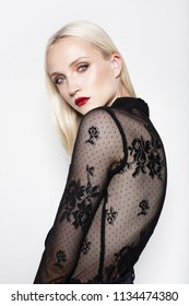 fashion model with straight blond hair and bright make-up. Red lips