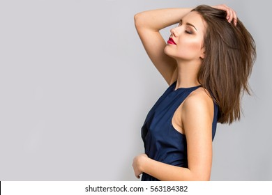 Fashion model with straight hair. Young beautiful woman posing at studio