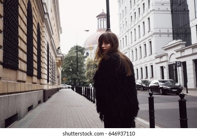 Fashion Model In Street. Beautiful Woman In Stylish Fashionable Clothes.