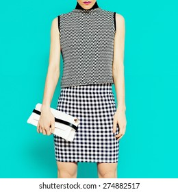 Fashion model in stylish clothes. Geometric combination trend