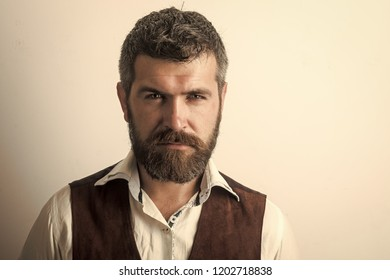 Fashion model with stylish hair isolated on white. Guy or bearded businessman. Man with long beard and mustache on serious face. Barber fashion and beauty. Hipster in shirt and waistcoat.