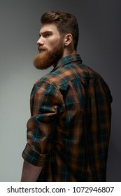 Fashion model with stylish hair. Man with long beard and mustache on serious face. Hipster in shirt. Barber fashion and beauty.