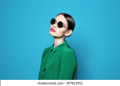 fashion model in sunglasses , beautiful young woman. Studio shot