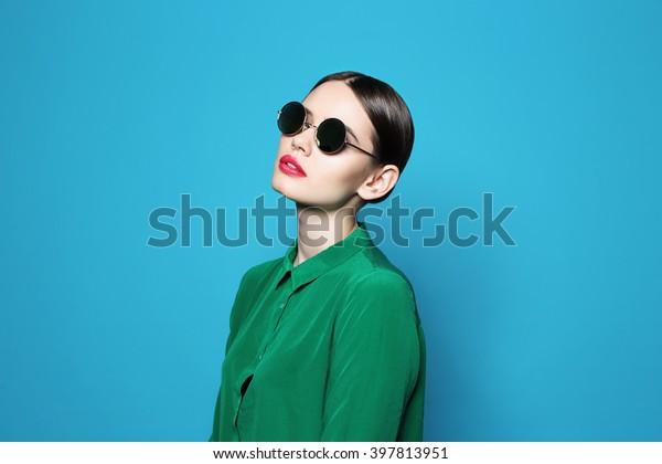 fashion model in sunglasses , beautiful young woman. Studio shot