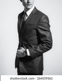Fashion model wearing fitted suit.