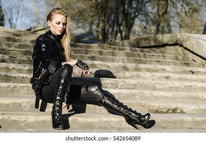 48392b8c7b4 Fashion model wearing leather pants and jacket posing