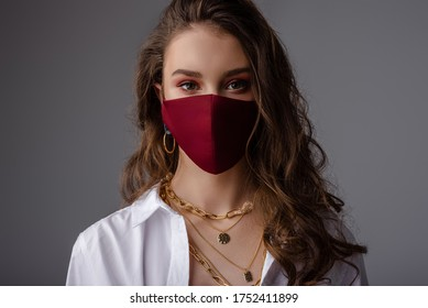 Fashion: model wearing trendy outfit with protective face mask. Stylish look during quarantine of coronavirus outbreak. Copy, empty space for text