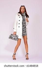 Fashion model wearing white coat - Autumn style