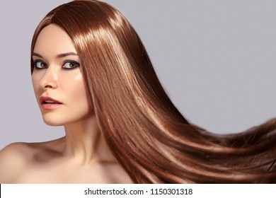 Fashion Model Woman with Beautiful Long Blowing Hair. Glamour Sexy Woman with Healthy and Beauty Flying Brown Hair. Skin Care and Hairstyle concept