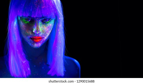Fashion model woman in neon light, beautiful model girl colorful bright fluorescent make-up, painted skin, Body Art design of disco. Ultraviolet, UV, colorful make up. Night club. Isolated on black