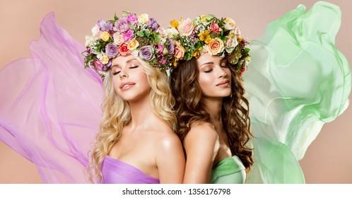 Fashion Models Flowers Wreath Hairstyle, Two Happy Women Beauty Portrait, Rose Flower in Hair, Studio Shot