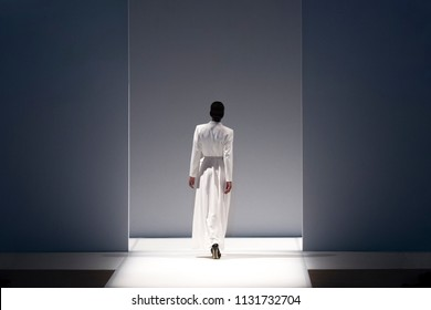 Fashion models on a catwalk during runway show.