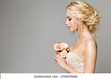 Fashion Models Profile Portrait with Flowers Bouquet, Beautiful Woman Bride Makeup and Hairstyle, Girl studio shot on gray background