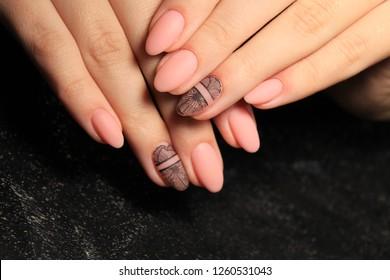 Fashion nails manicure on beautiful female hands