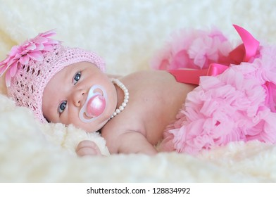 fashion newborn  girl wearing hat, pearl and skirt