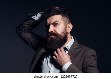 Fashion is not art but business. Man with long beard in business wear. Business as usual. Bearded man after barber shop. Mens fashion. No barber shaves so close.