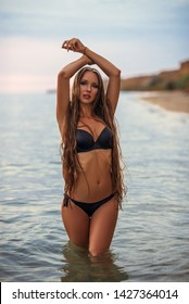 fashion outdoor photo of beautiful woman with blond hair in sexy bikini relaxing on summer beach