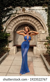 fashion outdoor photo of beautiful woman with blond hair in elegant clothes posing in antic historical place