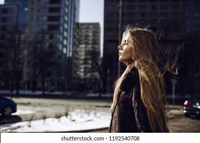 Fashion outdoor photo of a gorgeous sensual woman with blond hair in elegant clothes and a luxurious coat, walk in the autumn city