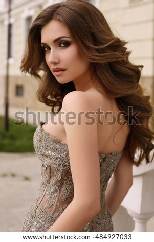 bb7bc60469066 fashion outdoor photo of gorgeous woman with dark curly hair in luxurious  sequin dress