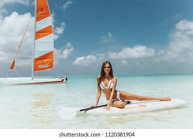 fashion outdoor photo of sexy woman with perfect body in luxurious swimming suit relaxing on Maldive island