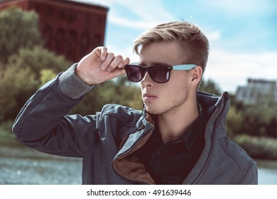 Fashion outdoor photo of stylish handsome man with sunglasses