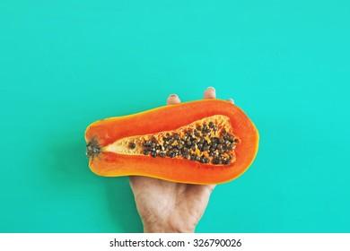 Fashion papaya in bright color style. Minimalism.