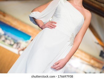Fashion parade, woman with white dress