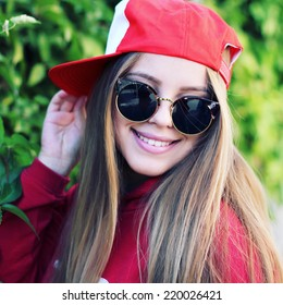 Fashion party girl wearing swag hats and sunglasses. Modern lifestyle concept. Photo toned style instagram filters.