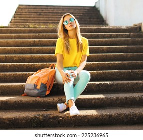 Fashion and people concept - lifestyle portrait stylish pretty girl in sunglasses posing in the city, street fashion