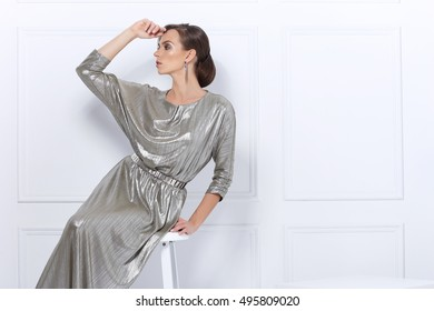Fashion photo of beautiful lady in elegant evening dress. Studio shot