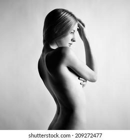 Fashion photo of beautiful nude woman. Black and white photography