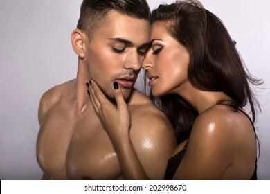 fashion photo of beautiful sexy couple posing at studio