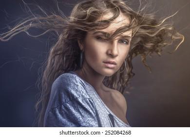 Fashion photo of beautiful woman posing on bright background