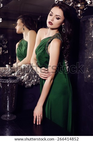 4ae874ca8e6 fashion photo of gorgeous woman with long dark hair in elegant green silk  dress posing in luxurious interior - Image