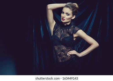 fashion photo of sexy brunette woman wearing lace top