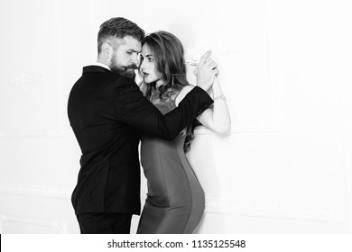 Fashion photo of sexy elegant couple in tender passion. Handsome brutal bearded man in suit and sexy amazing girl. Portrait of beautiful couple. Sexy couple, sensual couple, passion. Black and white.