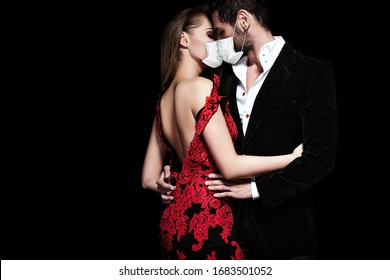 Fashion photo of sexy elegant couple in face mask