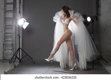 Fashion photo of a sexy woman. Image of the same fashion model in different poses. Fashion girl model posing on grey background in the studio. Fashion photo shoot.